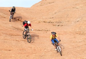 3 Bikers Ride Down the Slickrock Bike Trail