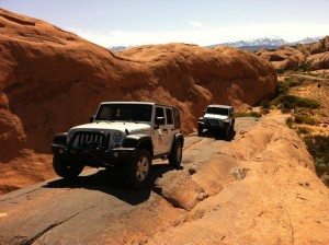 Two 4x4 Vehicles on Hells Revenge Trail Edge